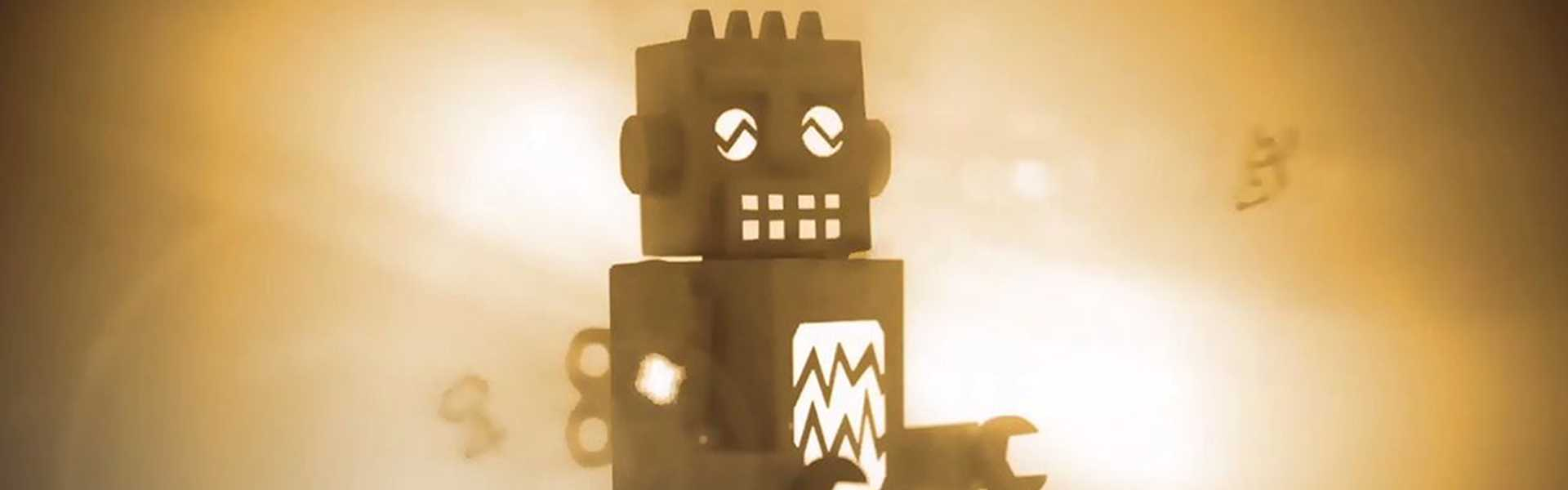 A CGI toy robot in papercut style surrounded by a warm glow and light flairs