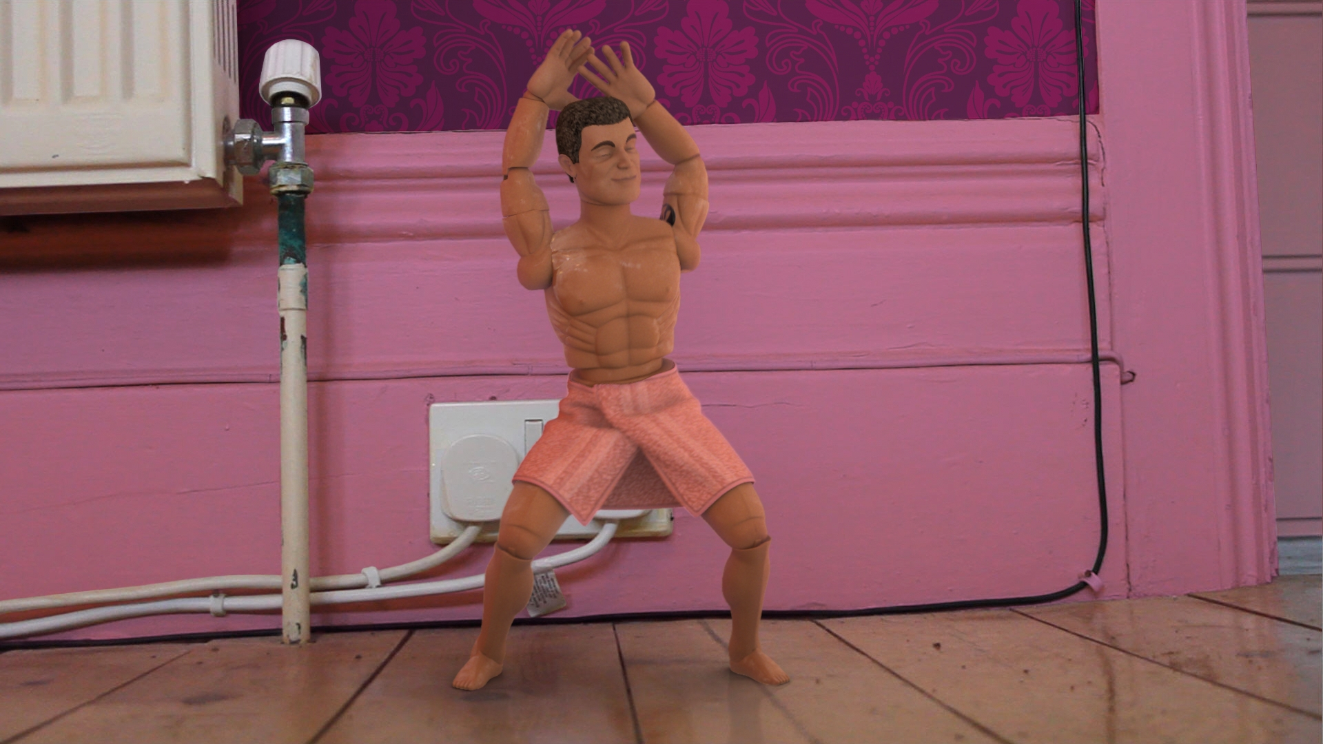 A CGI action man doll dancing in a CGI living room